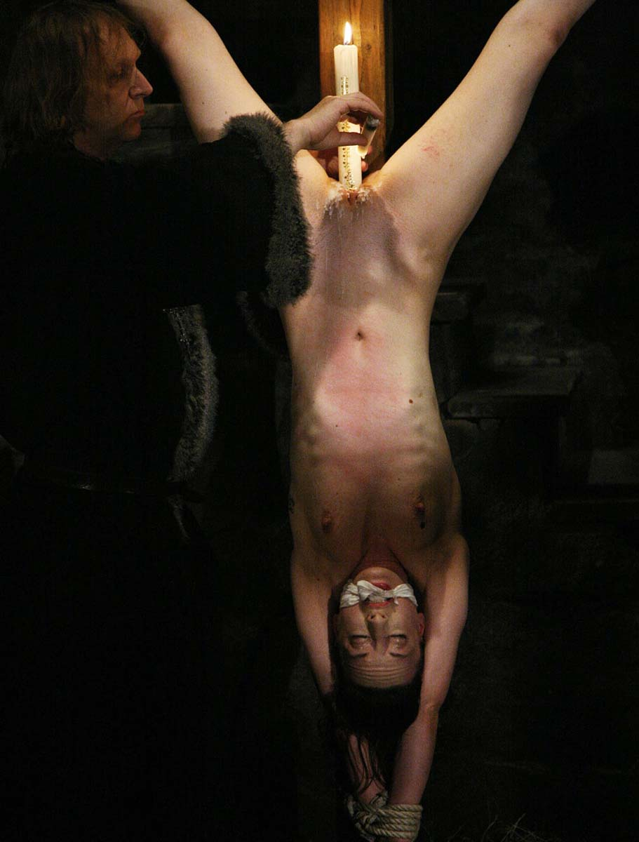 Mathilda endures pussy candle torture nude at the Brutal Dungeon.