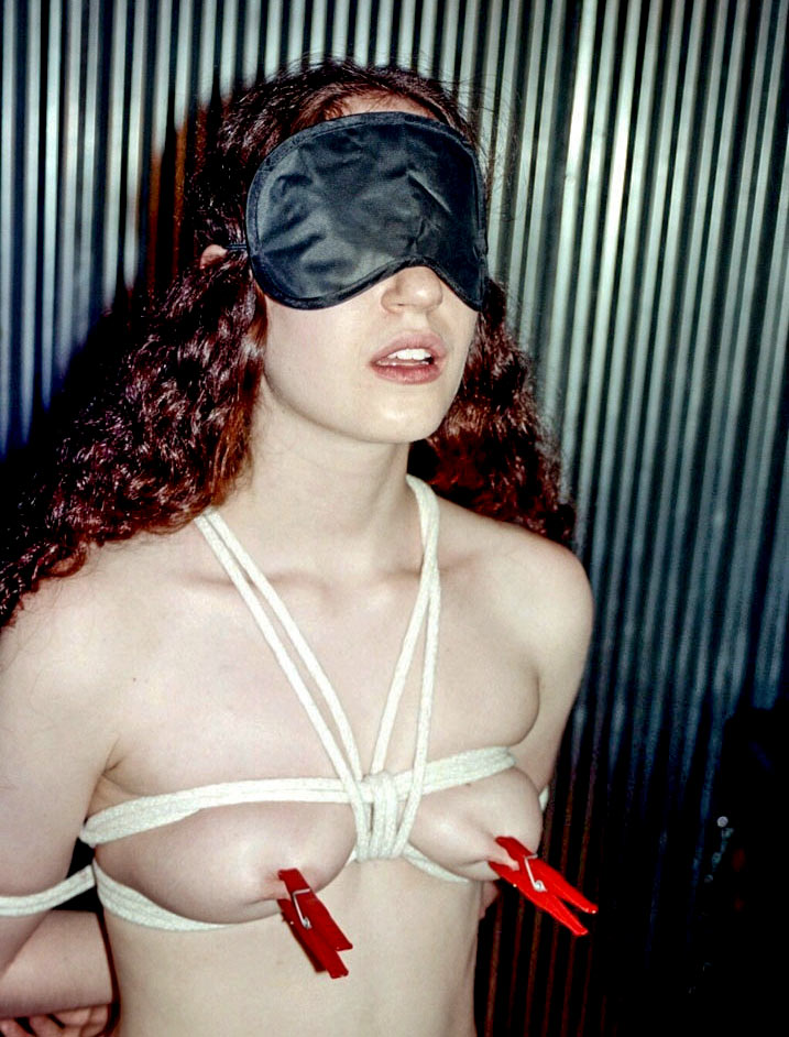 Jane, nude, blindfolded and bound by Rick Savage.