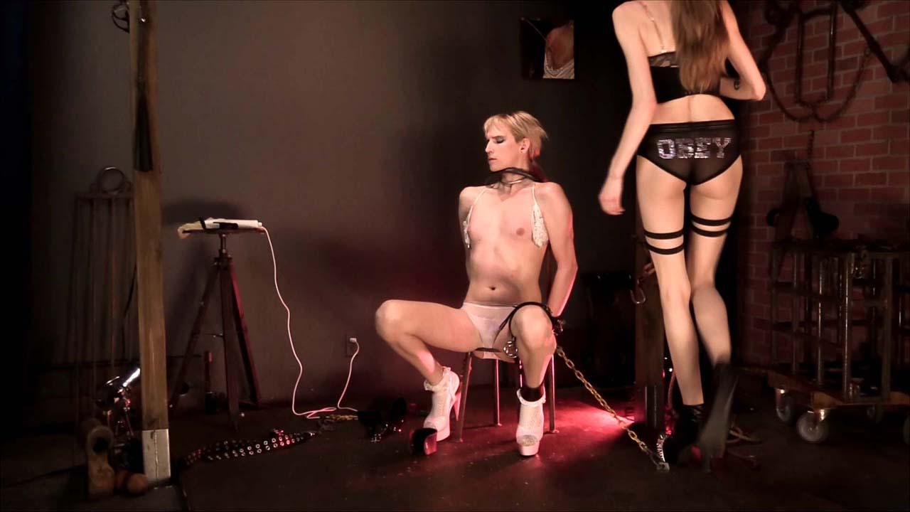 Master Kyaa tortures Slave River Enza in the LezDom BDSM video Hot Seat at Sensual Pain.