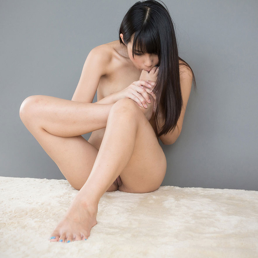 Kotomi Shinosaki toe sucking nude in an uncensored foot fetish video at LegsJapan.