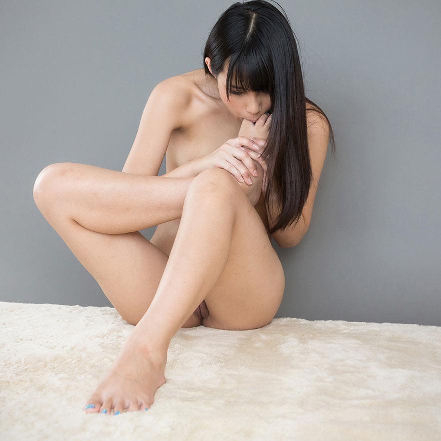 Kotomi Shinosaki toe sucking nude in an uncensored foot fetish video at LegsJapan.