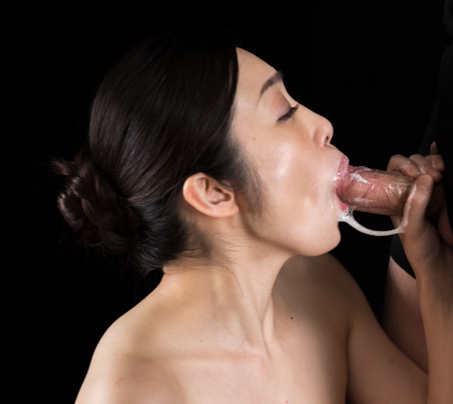 Blowjob, BJ, Fellatio,oral sex. A nude girl giving head by sucking cock. Ryu Enami in an uncensored Blowjob video at SpermMania.
